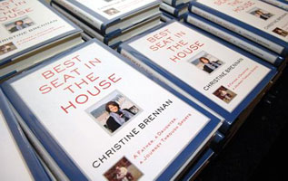 Copies of Christine Brennan's book at the December event.