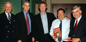 "At the first Great Fenway Park Writers Series event in 2005, its chairman, George Mitrovich, is seen with former Congressman and 9/11 Commission member Tim Roemer, ""Reversing the Curse"" author Dan Shaughnessy, Red Sox Executive Vice President for Public Affairs Dr. Charles Steinberg, and former Massachusetts Governor Mike Dukakis."