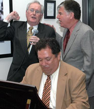 Poet Laureate Dick Flavin and Congressman Marty Meehan together singing an Irish ballad at the dinner, with Red Sox VP for Public Affairs Dr. Charles Steinberg at the Boston Baby Grand.