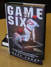 """Game Six"" by Mark Frost, awaits his autograph at a Writers Series luncheon."