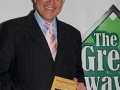 "Jim Nantz at the Writers Series with a copy of his book, ""Always at my Side"", the touching memoir of his late father."